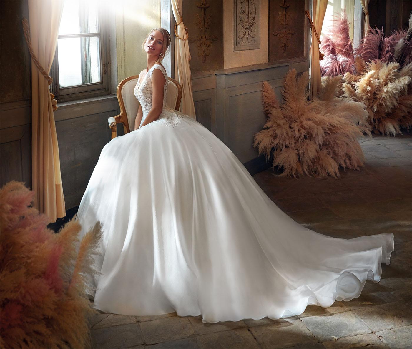 Abito da sposa in pizzo guipure e maniche chandelier staccabili